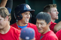 Oklahoma City RedHawks outfielder George Springer (8) is laughs with his teammates in the dugout after hitting his second home run of the game in the Pacific Coast League baseball game against the Round Rock Express on July 9, 2013 at the Dell Diamond in Round Rock, Texas. Round Rock defeated Oklahoma City 11-8. (Andrew Woolley/Four Seam Images)