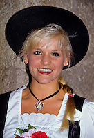 Portrait of German blond and pretty girl in octoberfest costume in Disneyworld