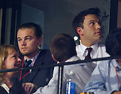 Boston, MA - July 29, 2004 -- Leonardo DiCaprio and Ben Affleck watch the proceedings at the 2004 Democratic National Convention in Boston, Massachusetts on July 29, 2004 from a VIP sky suite..Credit: Ron Sachs / CNP