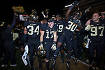 Alex Bachman (17), Ja'Cquez Williams (30), Loic Nya (59), Ben Brown (97), and Demetrius Kemp (34) celebrate following their win over the North Carolina State Wolfpack at BB&T Field on November 18, 2017 in Winston-Salem, North Carolina.  The Demon Deacons defeated the Wolfpack 30-24.  (Brian Westerholt/Sports On Film)