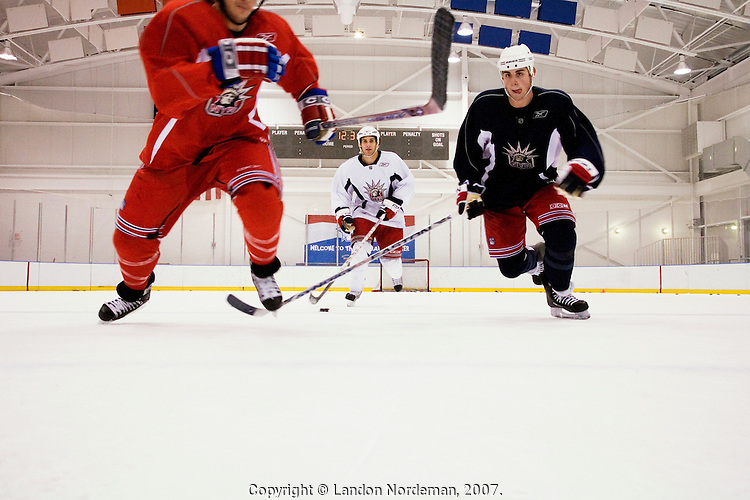 NEW YORK - DEC 13: The New York Rangers professional ice hockey team conducts practice on Thursday, December 13, 2007, in Tarrytown, New York. Ryan Callahan, left, Dan Girardi, center, and Brandon Dubinsky, right skate up the ice during a Rangers practice.   Their home games are played at Madison Square Garden in New York City. (Photo by Landon Nordeman).