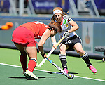 The Hague, Netherlands, June 13: Nina Hasselmann #10 of Germany defends during the match during the field hockey placement match (Women - Place 7th/8th) between Korea and Germany on June 13, 2014 during the World Cup 2014 at Kyocera Stadium in The Hague, Netherlands. Final score 4-2 (2-0)  (Photo by Dirk Markgraf / www.265-images.com) *** Local caption ***