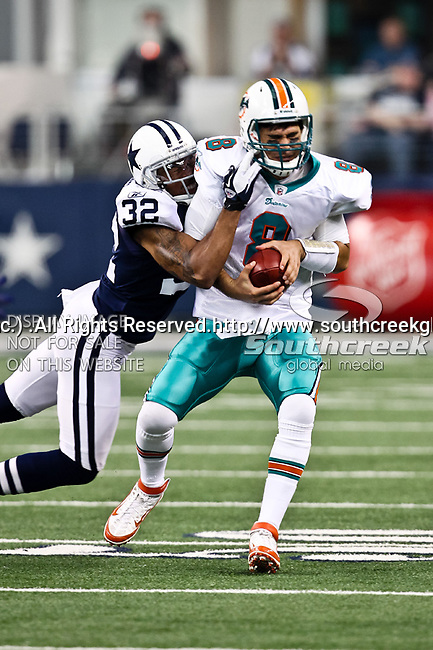 Dallas Cowboys cornerback Orlando Scandrick (32) and Miami Dolphins quarterback Matt Moore (8) in action during the Thanksgiving Day game between the Miami Dolphins and the Dallas Cowboys at the Cowboys Stadium in Arlington, Texas. Dallas defeats Miami 20 to 19...