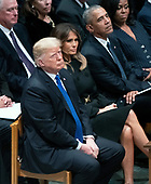 United States President Donald J. Trump looks on during the National funeral service in honor of the late former United States President George H.W. Bush at the Washington National Cathedral in Washington, DC on Wednesday, December 5, 2018.  Also pictured are: First lady Melania Trump, former US President Barack Obama, former first lady Michelle Obama.  Former US Vice President Dan Quayle is pictured at top left.<br /> Credit: Ron Sachs / CNP<br /> (RESTRICTION: NO New York or New Jersey Newspapers or newspapers within a 75 mile radius of New York City)
