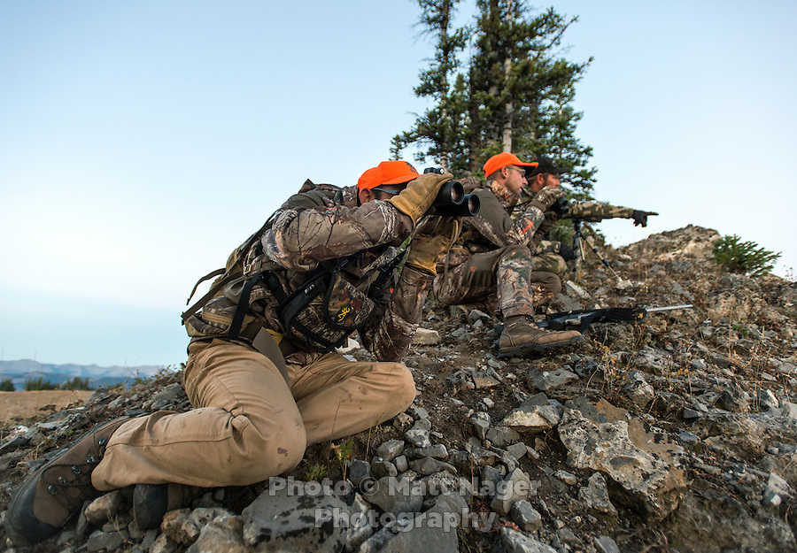 Outdoor Life Editor Andrew McKean, Mike Stock, and guide Greg Kriese with Trefren Outfitters scope a mountainside on Greyback Ridge in the Hoeback Drainage of Wyoming Region H, outside of Alpine, Wyoming, September 23, 2015.<br /> <br /> Photo by Matt Nager