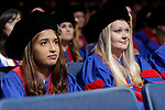 Students listen to remarks at the DePaul University College of Law commencement ceremony, Sunday, May 14, 2017, at the Rosemont Theatre in Rosemont, IL, where some 240 students received their Juris Doctors or Master of Laws degrees. (DePaul University/Jeff Carrion)