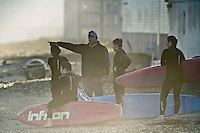 The board paddlers are given coaching direction during the Lyall Bay SLSC's late afternoon training session.