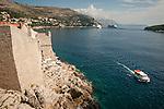 Walled city (stari grad) of Duvbrovnik, founded c. 972 along the Dalmatian Coast on the Adriatic Sea in Croatia--stone walls and the sea