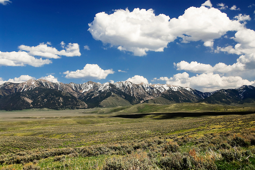A snowcapped Madison Mountain Range looms above the Madison Valley in southwest Montana.