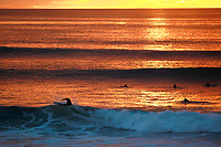 Jan. 25, 2014_San Diego_ California_USA_| A surfer rides a wave at Windansea in La Jolla during sunset.   | _Mandatory Photo Credit: Photo by K.C. Alfred/UT San Diego/Copyright 2014