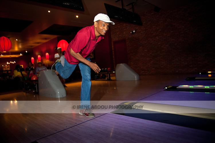 A man bowls at Lucky Strike Bowling Alley in Washington DC's Verizon Center.