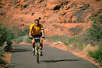 Bike riding on paved trail through Snow Canyon State Park, Ivins, Utah's Dixie; near St. George, UTAH
