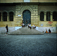 Musicians sit in front of a building in the Trastevere neighborhood in Rome, Italy in the summer of 2007.