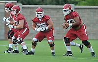 NWA Democrat-Gazette/MICHAEL WOODS &bull; @NWAMICHAELW<br /> University of Arkansas players Dan Skipper (70) Frank Ragnow (72) Mitch Smothers (65) and Sebastian Tretola (73) line up to run a play during the Arkansas Razorbacks practice Thursday August 6, 2015 in Fayetteville.