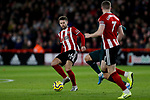 Oliver Norwood (L) passes towards John Lundstram of Sheffield United during the Premier League match at Bramall Lane, Sheffield. Picture date: 5th December 2019. Picture credit should read: James Wilson/Sportimage