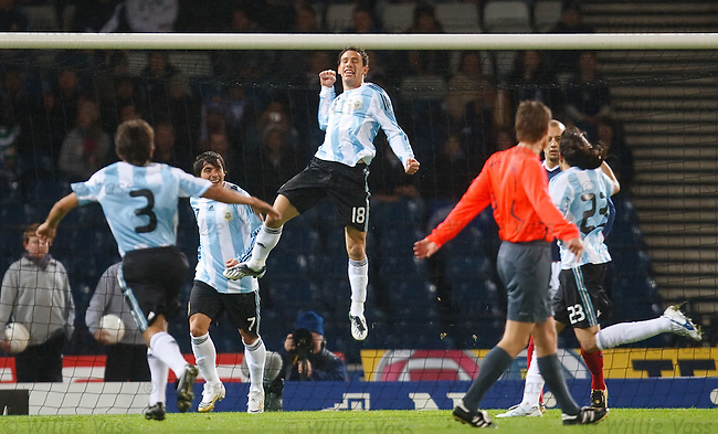 Maximiliano Rodriguez celebrates his goal against Scotland
