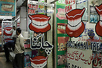 "In the old Saddar bazaar in Karachi, Pakistani dentists continue the tradition of street dentistry first bought to this city by Chinese immigrants.  Many such businesses continue to refer to themselves as 'China Destist"" and some even retain the original Chinese names."