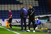 Oldham Athletic's manager Richie Wellens (L) and AFC Wimbledon manager Neal Ardley (R) during the Sky Bet League 1 match between Oldham Athletic and AFC Wimbledon at Boundary Park, Oldham, England on 21 November 2017. Photo by Juel Miah/PRiME Media Images