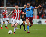 John Fleck of Sheffield Utd  tussles with Stephen Dawson of Scunthorpe Utd during the English League One match at Glanford Park Stadium, Scunthorpe. Picture date: September 24th, 2016. Pic Simon Bellis/Sportimage