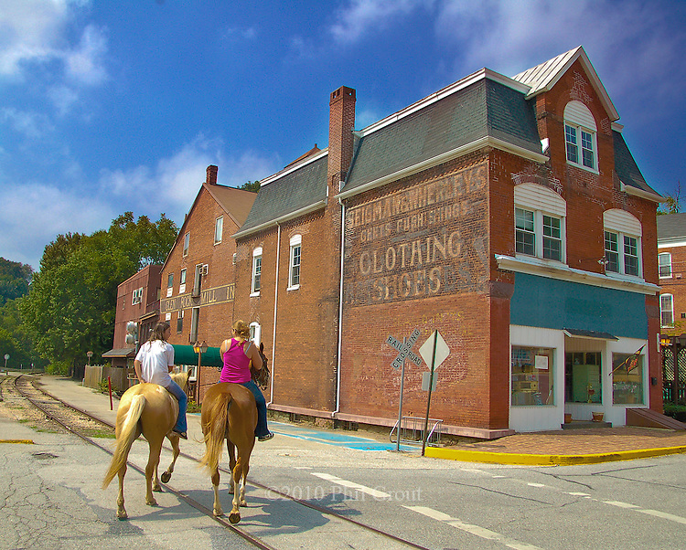 It was the railroad which these riders are crosssing and the mill in the background which combined in the mid 1800's to help make Glen Rock.a booming industrial center in southern York County.  Out for a.ride from nearby Seven Valleys are sisters Nicole (left) and Aby Taylor.