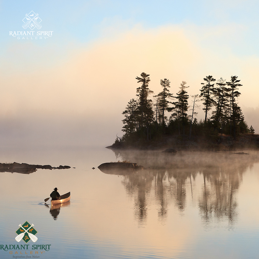 &quot;Paddling to Sunrise&quot;<br /> The canoeist enjoys a sunrise paddle on a cool, foggy morning in the Boundary Waters Canoe Area Wilderness (BWCAW). The wilderness is a treasure with endless beauty.