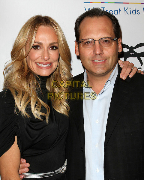TAYLOR ARMSTRONG & GUEST.CHLA'S 1st Annual Grayson's Gift Foundation held at Casa Del Mar Hotel, Santa Monica, CA, USA..November 11th, 2010.half length black dress suit blue shirt glasses smiling.CAP/ADM/FS.©Faye Sadou/AdMedia/Capital Pictures.