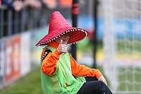 A Barnet ball-boy gets into the spirit of the game by wearing a Sombrero hat given to him by a Grimsby supporter during the Sky Bet League 2 match between Barnet and Grimsby Town at The Hive, London, England on 29 April 2017. Photo by David Horn.
