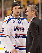 Ryan Dmowski (UML - 15), Norm Bazin (UML - Head Coach) The University of Massachusetts-Lowell River Hawks defeated the Boston College Eagles 4-3 to win the 2017 Hockey East tournament at TD Garden on Saturday, March 18, 2017, in Boston, Massachusetts.
