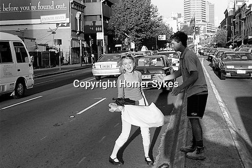 "Distressed young couple in the middle of the road, ""Before your found out"" Sydney Australia."