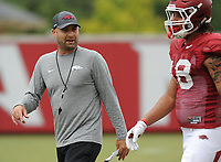 NWA Democrat-Gazette/ANDY SHUPE<br /> Arkansas assistant coach Barry Lunney speaks Tuesday, Aug. 1, 2017, with tight end Jeremy Patton during practice at the university's practice field in Fayetteville. Visit nwadg.com/photos to see more photographs from the day's practice.