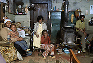 December 1976. Plains, Georgia. These families are the nearest neighbors of Jimmy Carter's family home. Their home has no running water and no sewage.