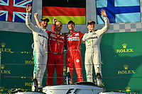 March 26, 2017: Lewis Hamilton (GBR) #44 from the Mercedes AMG Petronas team, Luigi Fraboni and Sebastian Vettel (DEU) #5 from the Scuderia Ferrari team and Valtteri Bottas (FIN) #77 from the Mercedes AMG Petronas team congratulate each other on the podium at the 2017 Australian Formula One Grand Prix at Albert Park, Melbourne, Australia. Photo Sydney Low