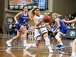 SIOUX FALLS, SD - NOVEMBER 15: South Dakota State Jackrabbits's Rylie Cascio Jensen #2 makes a no look pass to a teammate past a pair of defenders including Kynedi Cheeseman #30 from Dakota Wesleyan during their game Friday evening at the Sanford Pentagon in Sioux Falls, SD. (Photo by Dave Eggen/Inertia)