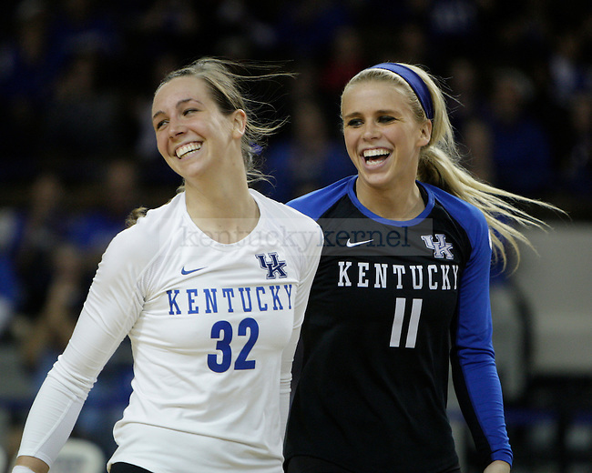 Senior Christine Hartmann (32) and senior Stephanie Klefot (11) celebrate after a match win during the UK women's volleyball game v. Ohio University during the second round of the NCAA tournament in Memorial Coliseum in Lexington, Ky., on Saturday, December 1, 2012. Photo by Genevieve Adams | Staff
