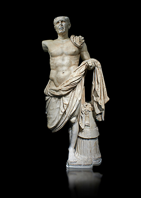 Roman Portrait statue of the so-called General Tivoli a Roman commander circa 70-70BC made in Greek marble and found in the excavation of the Temple of Hercules, Tivoli, Italy. A masterpiece of hoary sculpture from the late Republican period, this statue portrays an elderly person with a young, nude body. The cape (paludamentum) which covers part of the stomach and legs, and the cuirass embossed with the head of Medusa (lorica) which functions as a support, identify it as a high-ranking soldier. It can be presumed that the right arm is raised, as suggested by the chest muscles holdingg the shoulder, and that the figure was leaning on a lance. The style derives from Hellenistic designs pf 'hero nudity' (effigies schilleae) used, starting in the 2nd century BC, by members of the Roman ruling class which has a strong political need of self-representation. The authoritarian, imposing stance together with the marked realism of the facial features, is one of the best examples of Hellenistic bravura combined with realistic Italic tradition. Stylistic considerations and the fact that the statue was found in the excavation of the Temple of Hercules which was built during the dictatorship of Cornelius Sulla, date the statue to between 90 and 70 BC. Its commemoration in Tivoli leads us to believe that it may have been someone from the area, probably a lieutenant of Sulla who paid for the portrait himself, or that it was a public honour, in the most important shrine in the city, dedicated to the god-hero called 'Victor', i.e, the protector of military expeditions. The National Roman Museum, Rome, Italy