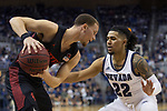 San Diego State guard Malachi Flynn (22) is guarded by Nevada guard Jazz Johnson (22) during the second half of a basketball game played at Lawlor Events Center in Reno, Nev., Saturday, Feb. 29, 2020. (AP Photo/Tom R. Smedes)