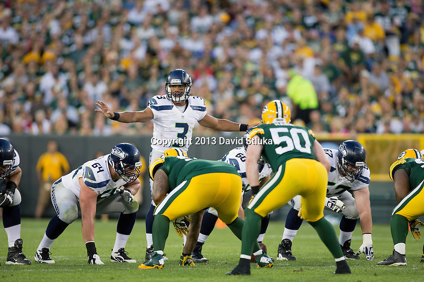 Seattle Seahawks quarterback Russell Wilson (3) calls an audible at the line of scrimmage during an NFL preseason week 3 football game against the Green Bay Packers Thursday, August 23, 2013, in Green Bay, Wis. The Seahawks won 17-10 . (Photo by David Stluka)
