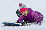 MIDDLEBURY CT. 11 December 2017-011718SV02-Nora Grealis, 7, of Middlebury slides down the hill between Town Hall and the Shepardson Center while sledding in Middlebury Wednesday.<br /> Steven Valenti Republican-American