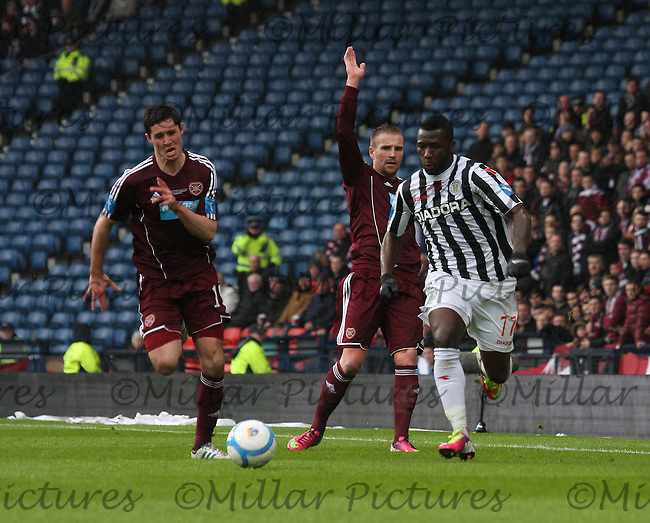 Dylan McGowan (left) chases Esmael Goncalves as Ryan Stevenson claims in the St Mirren v Heart of Midlothian Scottish Communities League Cup Final match played at Hampden Park, Glasgow on 17.3.13.