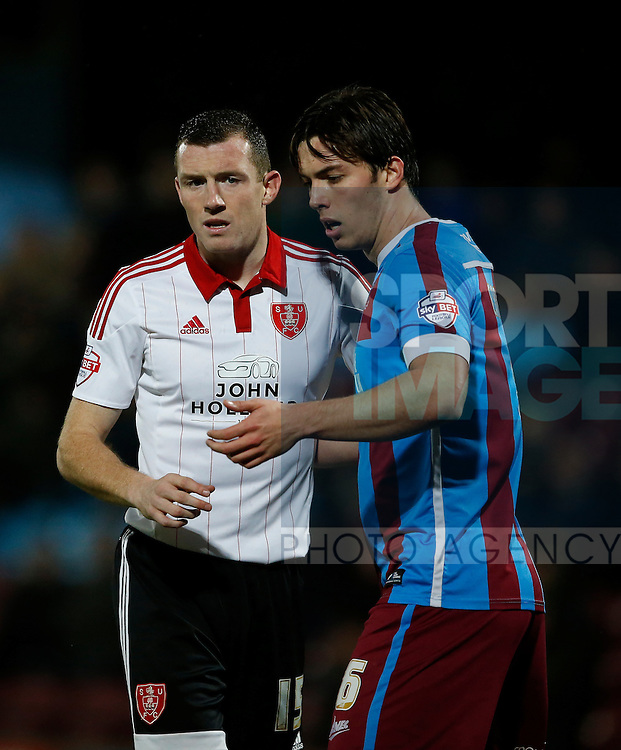 Neill Collins of Sheffield Utd marked by Niall Canavan of Scunthorpe Utd - English League One - Scunthorpe Utd vs Sheffield Utd - Glandford Park Stadium - Scunthorpe - England - 19th December 2015 - Pic Simon Bellis/Sportimage
