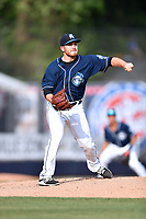 Asheville Tourists starting pitcher Ty Culbreth (38) attempts a pickoff during a game against the Greensboro Grasshoppers at McCormick Field on April 28, 2017 in Asheville, North Carolina. The Grasshoppers defeated the Tourists 7-4. (Tony Farlow/Four Seam Images)