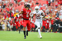 Landover, MD - September 1, 2018: Maryland Terrapins wide receiver Jeshaun Jones (6) taunts Texas Longhorns defensive back B.J. Foster (25) while running for a touchdown during the game between Texas and Maryland at  FedEx Field in Landover, MD.  (Photo by Elliott Brown/Media Images International)