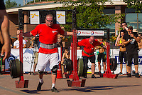 Participants compete during the Giants Live Strongman Competition in Budapest, Hungary on June 17, 2012. ATTILA VOLGYI