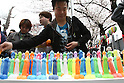 Apr 04, 2010 - Kawasaki, Japan - Phallus-shaped candles are on display for sale at the Kanamara Matsuri (Festival of the Steel Phallus) held in Wakamiya Hachimangu Shrine on April 4, 2010 in Kawasaki, Japan. The annual feritility festival, held traditionally the first Sunday in April, is said to encourage fertility and bring harmony to married couples. The festival has also become somewhat of a tourist attraction and is used to raise money for HIV research and awareness of AIDS prevention.