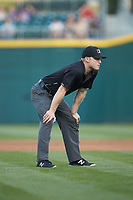Third base umpire Travis Godec works the International League game between the Toledo Mud Hens and the Charlotte Knights at BB&T BallPark on April 24, 2019 in Charlotte, North Carolina. The Knights defeated the Mud Hens 9-6. (Brian Westerholt/Four Seam Images)