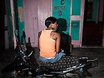 Woman on motorcycle, Jacmel.