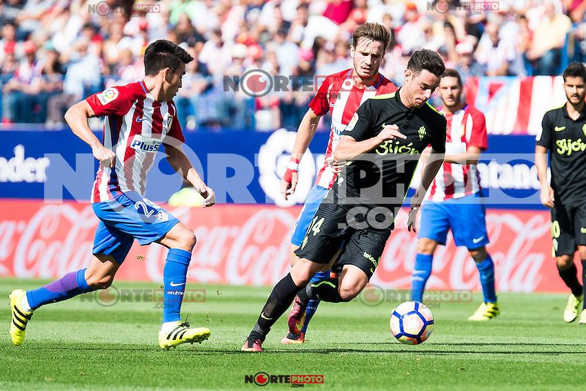 Atletico de Madrid's player Nico Gaitán and Saúl Ñígez and Sporting de Gijon's Burgui during a match of La Liga Santander at Vicente Calderon Stadium in Madrid. September 17, Spain. 2016. (ALTERPHOTOS/BorjaB.Hojas) /NORTEPHOTO