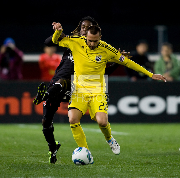Joseph Ngwenya (11) of D.C. United fights for the ball with Dejan Rusmir (22) of the Columbus Crew during the home opener at RFK Stadium in Washington D.C.  D.C. United defeated the Columbus Crew, 3-1.