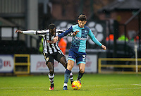 Joe Jacobson of Wycombe Wanderers holds off Jonathan Forte of Notts County during the Sky Bet League 2 match between Notts County and Wycombe Wanderers at Meadow Lane, Nottingham, England on 10 December 2016. Photo by Andy Rowland.