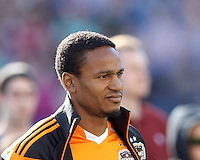 Houston Dynamo midfielder Ricardo Clark (13). In a Major League Soccer (MLS) match, the New England Revolution (blue/white) defeated Houston Dynamo (orange), 2-0, at Gillette Stadium on April 12, 2014.